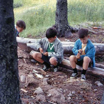 Brothers Jason, Shane and Kent Wilson with jack knives carving, Baddeck, Nova Scotia, late 1960's
